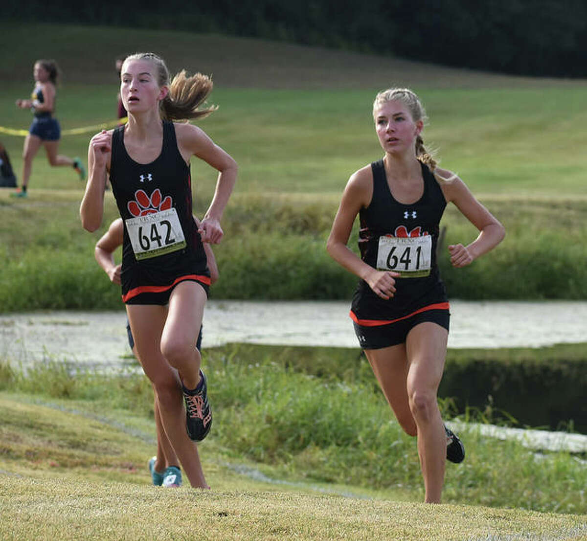 Edwardsville's Maya, right, and Makenna Lueking run in the Southwestern Conference Meet at Clinton Hills in Swansea.