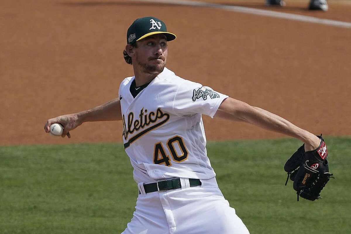 Oakland Athletics' Chris Bassitt (40) pitches against the Houston Astros during the first inning of Game 1 of a baseball American League Division Series in Los Angeles, Monday, Oct. 5, 2020. (AP Photo/Marcio Jose Sanchez)