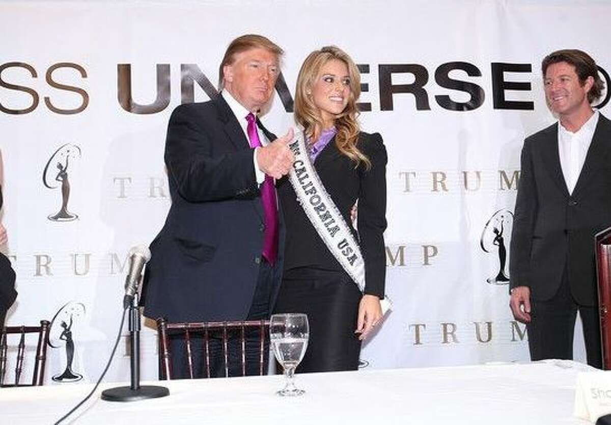 Keith Lewis, far right, stands with then Miss Universe President Donald Trump and Miss California Carrie Prejean