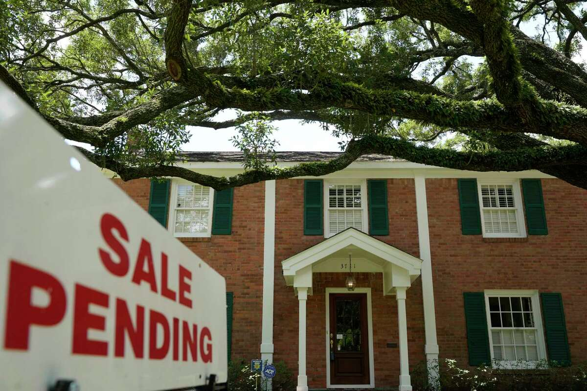 A sign is displayed outside a home for sale Thursday, July 30, 2020, in Houston.