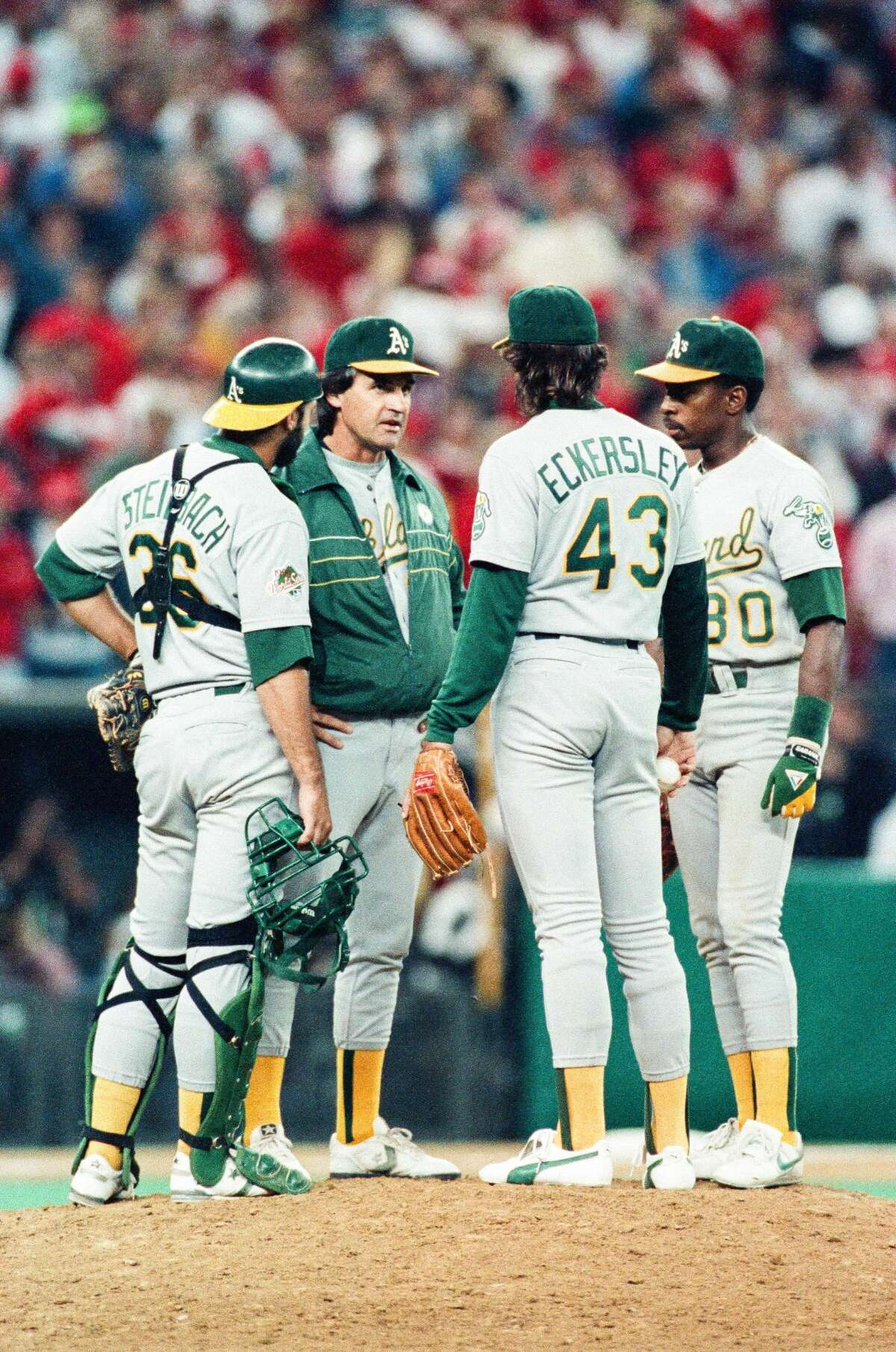 Tony La Russa talks with Dennis Eckersley of the Oakland Athletics during the 1990 World Series against the Cincinnati Reds at Riverfront Stadium in Cincinnati, Ohio.