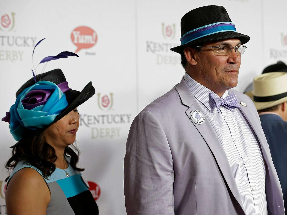 Carolina Panthers head coach Ron Rivera arrives with his wife Stephanie to attend the 139th Kentucky Derby at Churchill Downs Saturday, May 4, 2013, in Louisville, Ky. Rivera and his wife have donated $500,000 to the University of California softball program.