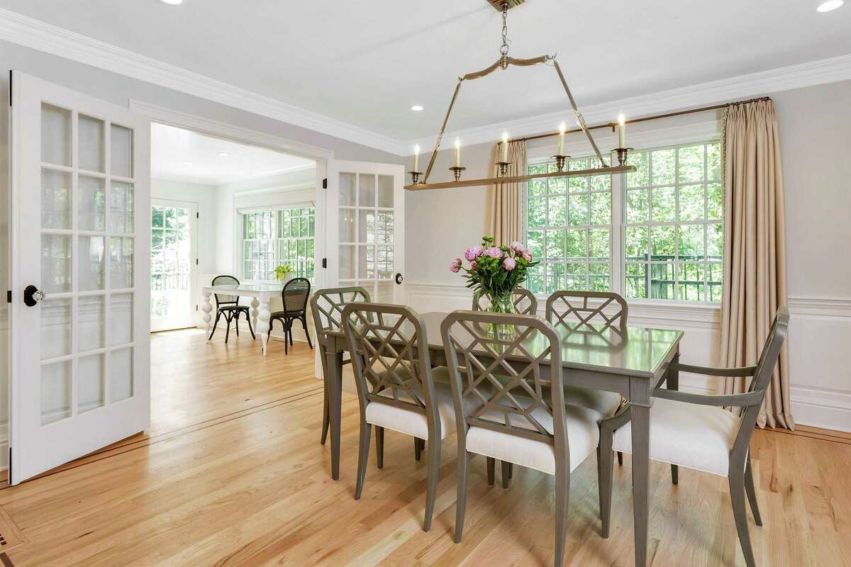 """""""I just love the open floor plan, the updated finishes and the flow of the house,"""" Hanley said. The white home - which is professionally landscaped, has flowering trees and sits on a cul-de-sac - has had many recent updates and improvements. They include hardwood floors put down in August, newly painted garage doors, a new dishwasher put in this month, the house being power washed in September and the master bedroom being freshly painted. In the dining room, the light fixtures were put in two years ago, and the kitchen was updated in 2019. The living room was painted white last year. The home - which is 2,250 square feet and sits on 0.54-acres - has a basement for storage, a main level, second level and hatch attic."""