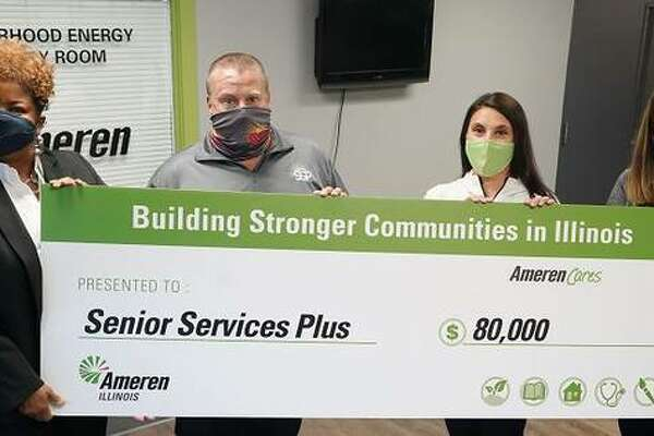 Paula Nixon, left, Ameren Illinois Community Relations Executive, and Kim Voypick, right, Ameren Illinois, Director of Electric Operations, Ameren Illinois, present an $80,000 contribution to Senior Services Plus in Alton. Accepting the donation on behalf of the organization is Steve McEwen, Director of Handyman and HVAC services for SSP, and Theresa Collins, interim CEO of SSP.