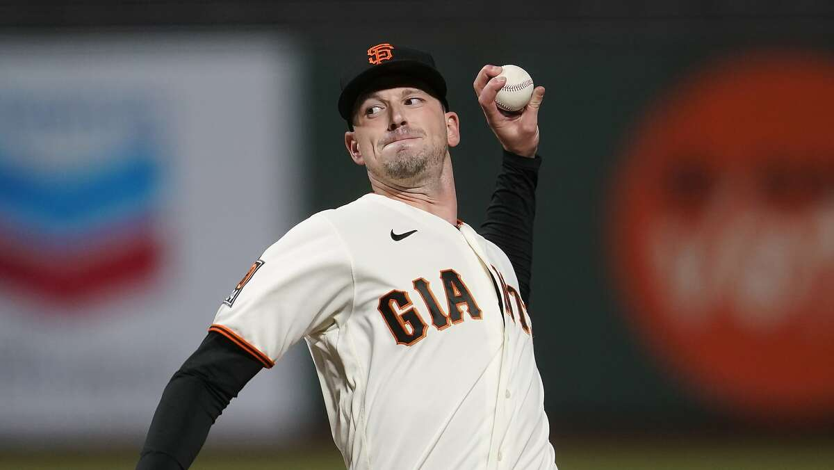 San Francisco Giants starting pitcher Drew Smyly (18) throws against the Colorado Rockies during the third inning of a baseball game in San Francisco, Tuesday, Sept. 22, 2020. (AP Photo/Jeff Chiu)