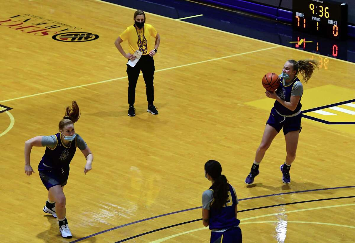 University at Albany head coach Colleen Mullen watches her players run a drill as the women's basketball team practices on Wednesday, Oct. 21, 2020 in Albany, N.Y. (Lori Van Buren/Times Union)