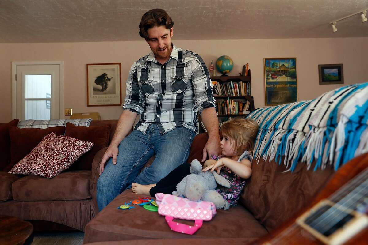 Michael Michalske spends time with his daughter, Fiona, at his in-laws' home in Templeton on Wednesday. The pandemic has been hard on many families.