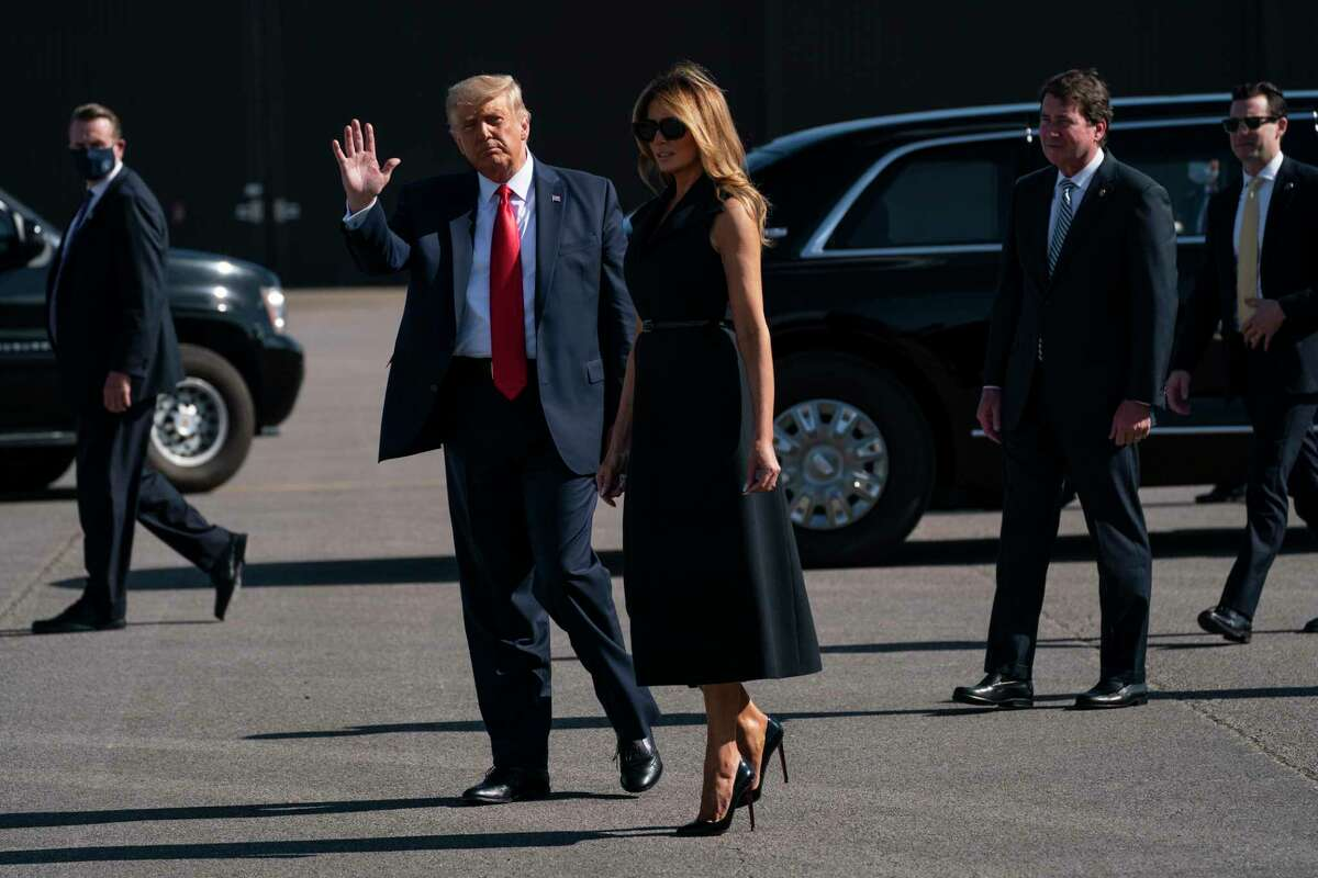 President Donald Trump and first lady Melania Trump arrive at Nashville International Airport ahead of the presidential debate, Thursday, Oct. 22, 2020, in Nashville.