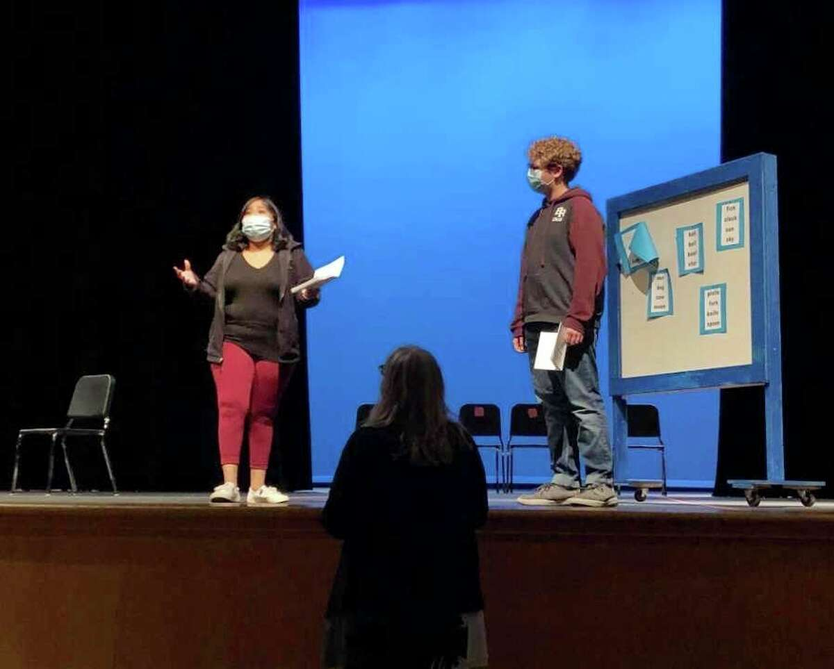Lori Hathaway (center) directs Kathryn Keller (left) and Alek Lipar (right) in Small Actors. (Courtesy photo)