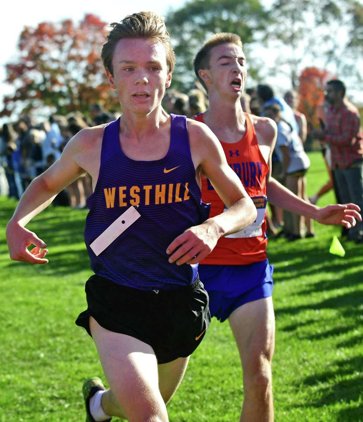 Westhill's Colin McLaughlin barley beats out Danbury's Jack Watson for seventh place during a meet in 2019.