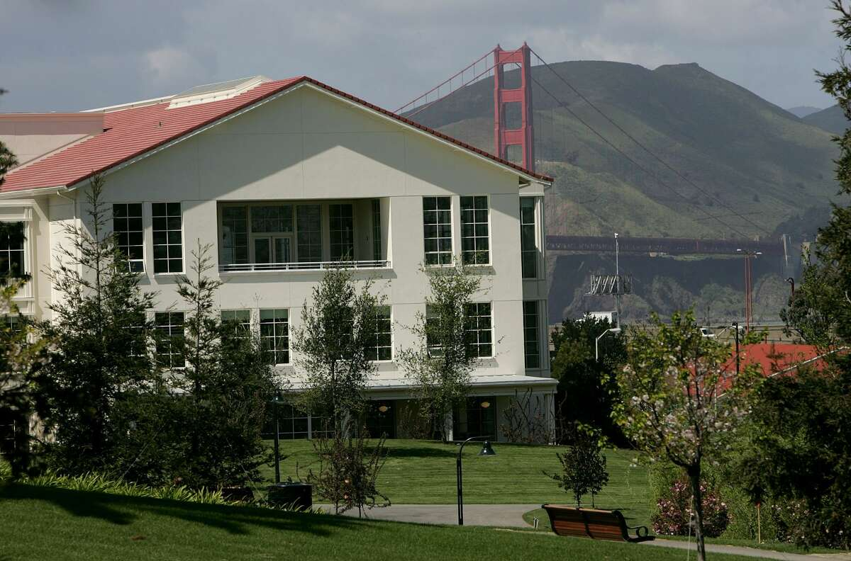The Golden Gate Bridge is seen from behind a building that was once the U.S. Army's Letterman Hospital in the San Francisco Presidio.