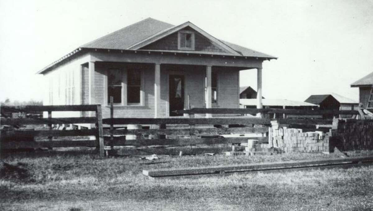 The W.A. Dean home under construction in 1919 on Commerce Street in Magnolia. W.A. Dean and Gertrude Cook Dean married in June 1920 and lived in the home until his death in 1963. The structure is now a CPA's office. A Montgomery County Historical Marker will be dedicated there on Monday.