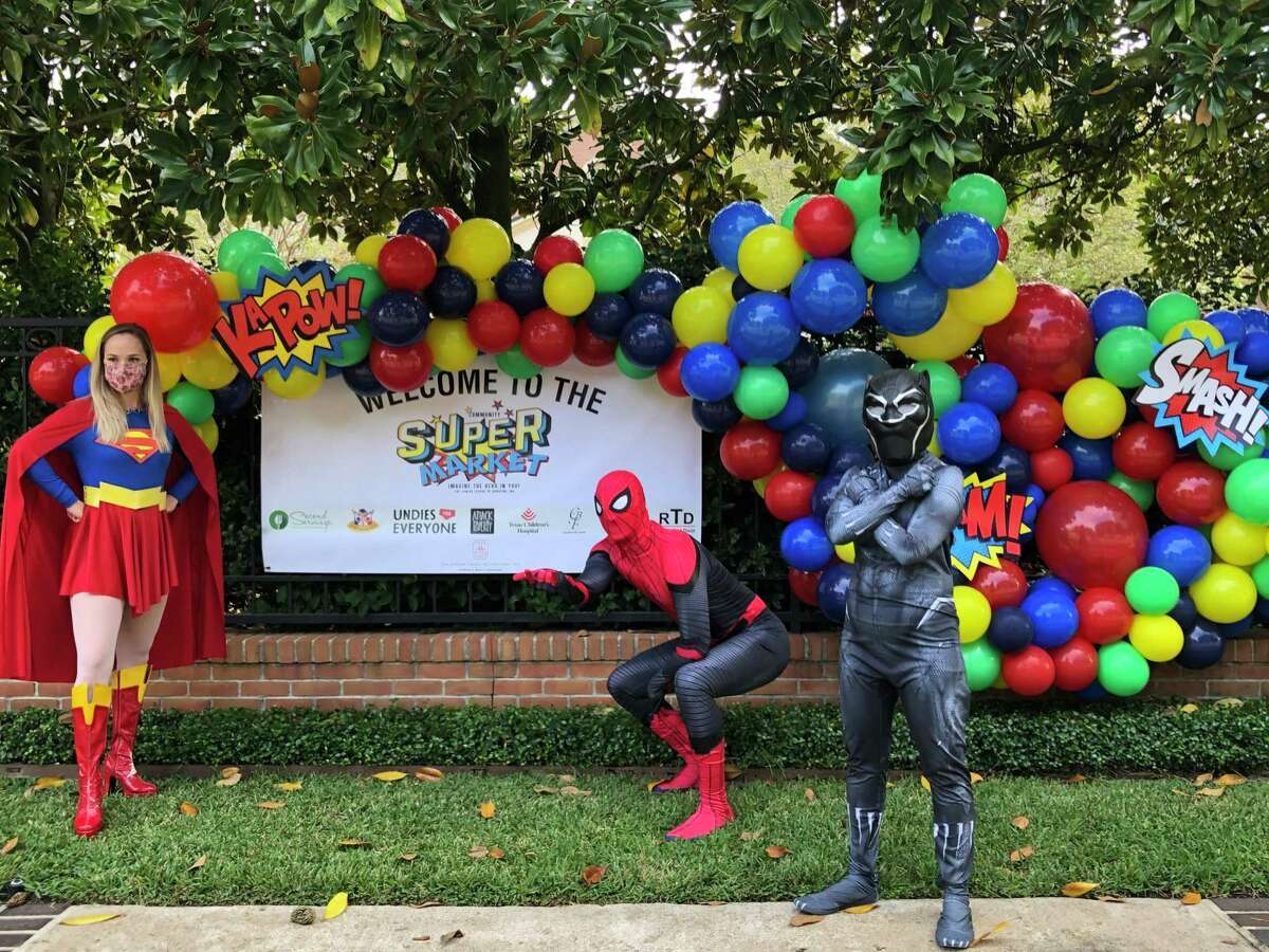 Super hero volunteers at the inaugural Junior League Community 'Super Market.'
