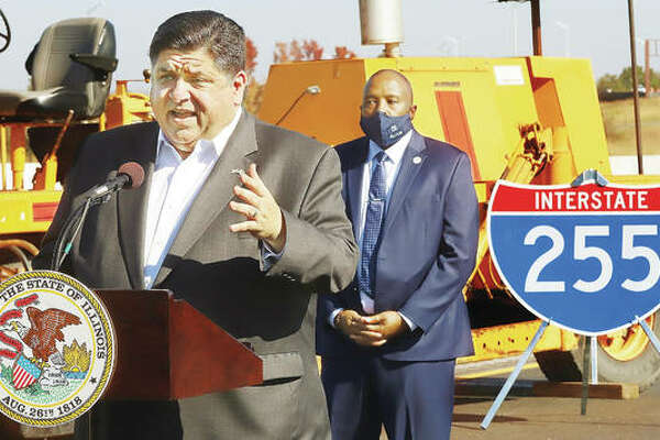 Standing on Interstate 255 Thursday south of the I-64 interchange, Gov. J.B. Pritzker congratulates construction workers on completing the renovations and repaving of the interstate south to Illinois 15 ahead of schedule. The $67 million repair job is expected to open to traffic in about two weeks.