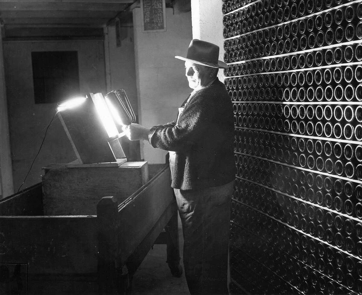Wines are checked forclarity while being bottle-aged at Beaulieu Winery, May, 1947.