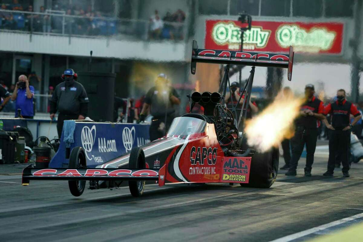 In this photo provided by the NHRA, points leader Steve Torrence powers to his second No. 1 qualifier of the season in his dragster at the AAA Texas NHRA FallNationals in Dallas on Oct. 17.