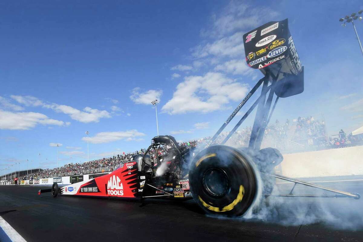 In this photo provided by the NHRA, Doug Kalitta does a burnout in Top Fuel at the Mopar Express Lane NHRA Midwest Nationals drag races at World Wide Technology Raceway on Oct. 4 in Madison, Ill. Kalitta won for the fourth time at the St. Louis-area track, beating Steve Torrence in the final round with a 3.690-second run at 322.58 mph.