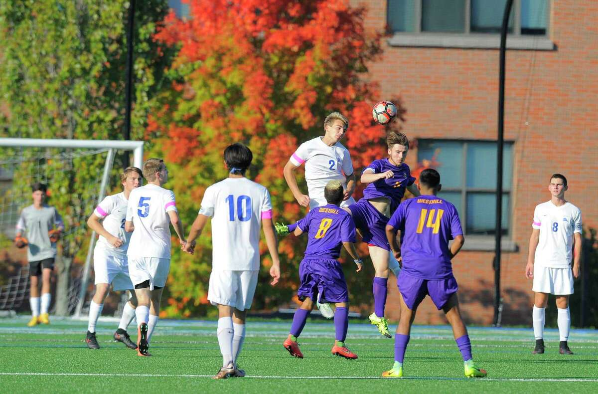 Westhill and Darien meet in a 2016 boys soccer game. The two schools recently postponed a game due to coronavirus complications.