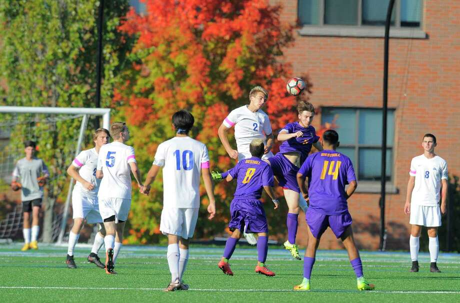 Westhill and Darien meet in a 2016 boys soccer game. The two schools recently postponed a game due to coronavirus complications. Photo: Matthew Brown / Hearst Connecticut Media / Stamford Advocate