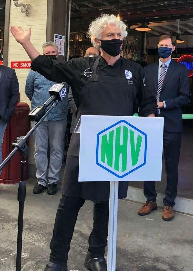 Arturo Franco Camacho, co-owner of Camacho Garage. Mayor Justin Elicker is at right. Photo: Jennifer Kaylin / Contributed Photo