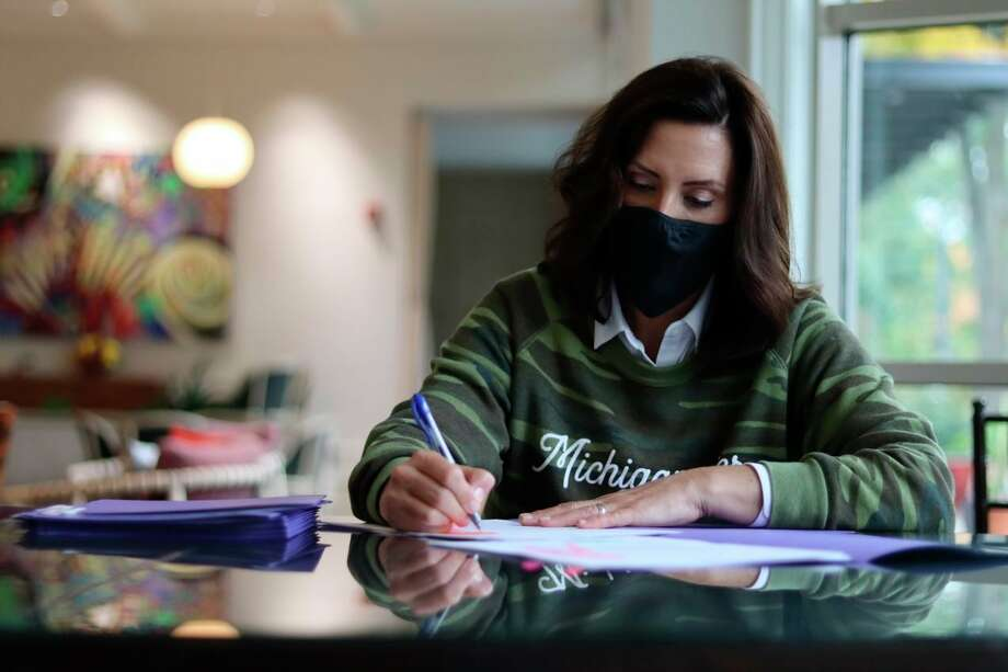 Gov. Gretchen Whitmer signed bipartisan House Bills 6030-6032 protecting Michigan workers from the spread of COVID-19 and protecting businesses that implement strict safety measures to keep workers, customers and their families safe. (Courtesy Photo)