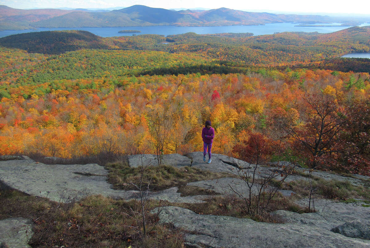 Herb Terns' daughter stands on Cat Mountain in the Adirondacks with Lake George behind her. (Herb Terns / Times Union)