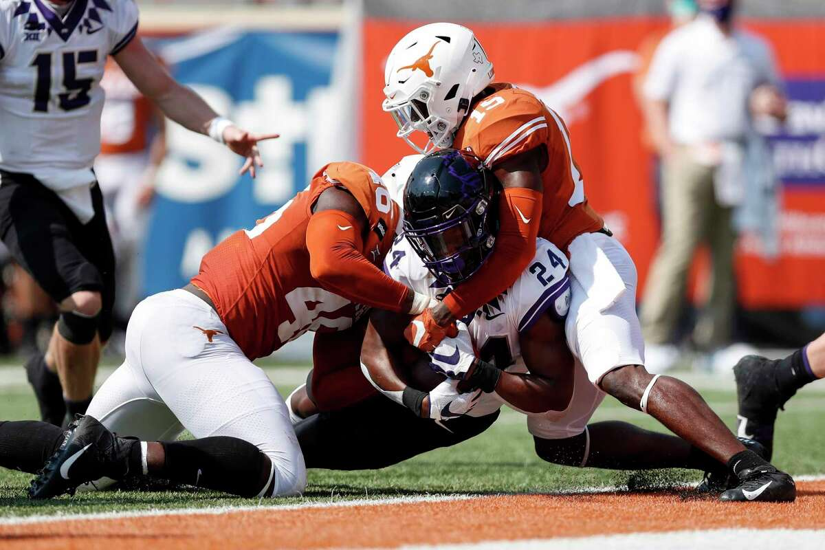 Joseph Ossai (46) and the Longhorns defense, allowing a touchdown to TCU's Darwin Barlow, have been inconsistent in team's first four games.