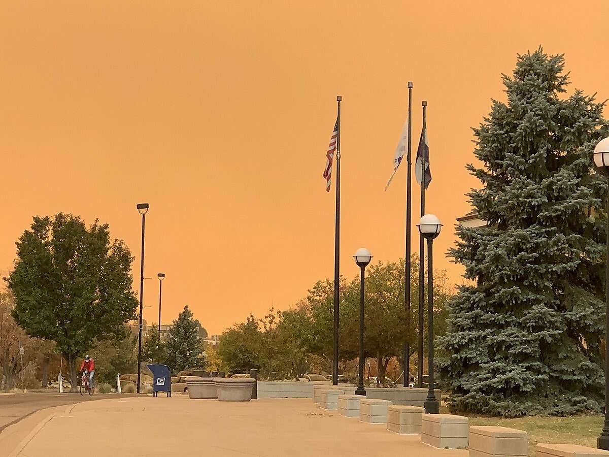 The sky is bright orange over Broomfield, Colo., on Oct. 16, 2020, as particulates from wildfire smoke filter the sunlight.