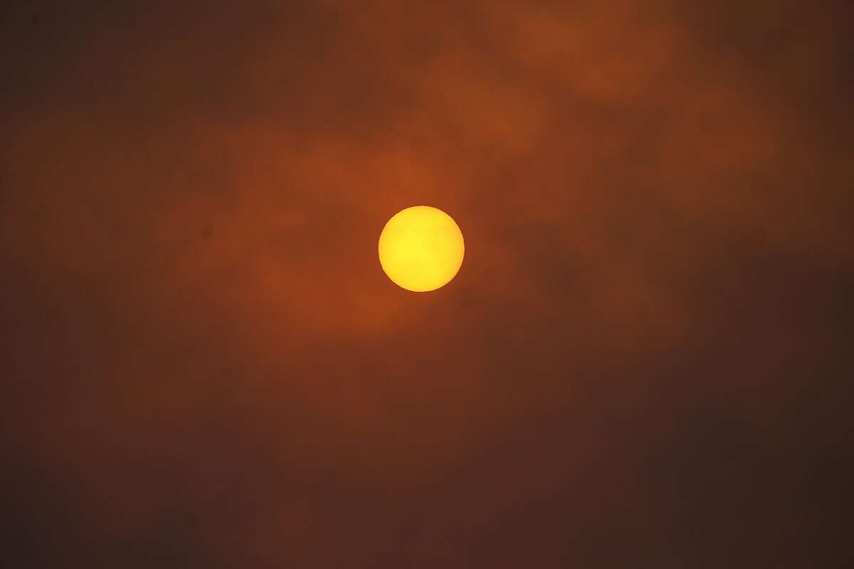The sun is obscured by smoke along Highway 7 as several wildfires burn in the state Wednesday, Oct. 21, 2020, in Lyons, Colo. (AP Photo/David Zalubowski)