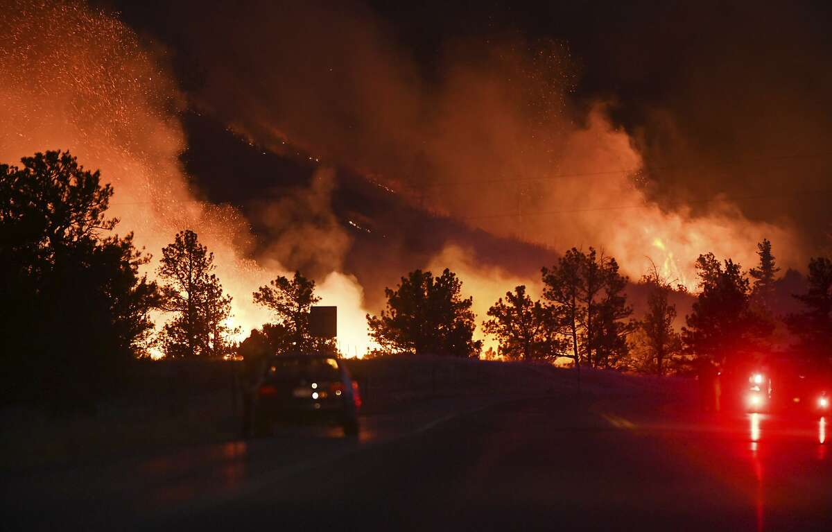 On Sunday, Oct. 11, 2020, the Wild Horse Fire kicks up along Hwy. 115, just south of Colorado Springs, Colo. Earlier in the afternoon, the fire started on the west side of the highway and eventually jumped to the Ft. Carson side. There were red flag warnings on Sunday with 40-50 mph at the time of the fire. There were about 100 firefighters from15 different agencies dispatched to the fire. (Jerilee Bennett/The Gazette via AP)