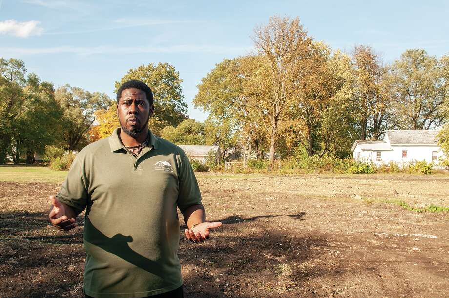 Samuel Holmes Jr. stands at North Clay Avenue and East Walcott Street as he describes the Humble Beginnings Outreach Center that is slated to be completed by summer. Phase 1 of the project will be a 4,000-square-foot building providing office space for rent and a recreational area for kids. Photo: Darren Iozia | Journal-Courier / Jacksonville Journal-Courier