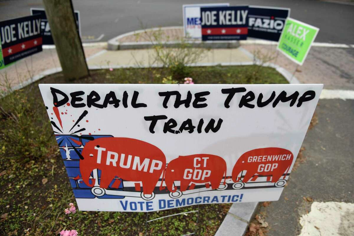 """A sign displaying the message """"Derail the Trump train"""" is up at the intersection of Sound Beach Avenue and Shore Road in Old Greenwich, Conn. Thursday, Oct. 22, 2020."""