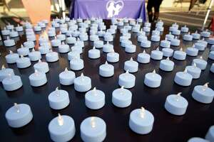 Flameless candles flicker during a candle light vigil held at St. Mary Magdalene Catholic Church, Wednesday, Oct. 21, 2020. FamilyTime Crisis and Counseling Center turned a candle on for every victim of domestic violence so far this year, an estimated 185.