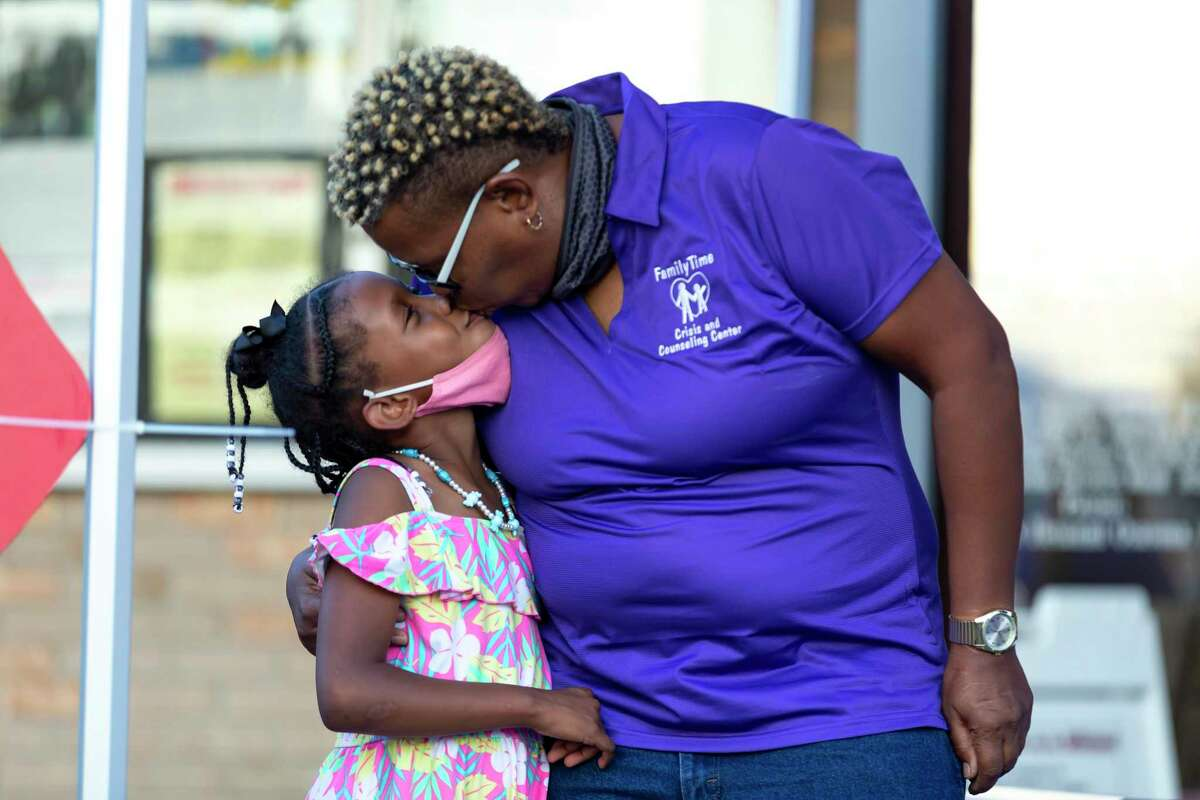 Hope Linthicum embraces her daughter, Angel, during a candlelight vigil held at St. Mary Magdalene Catholic Church, Wednesday, Oct. 21, 2020. Hope sought out FamilyTime Crisis and Counseling when she needed resources and shelter when she faced domestic violence.