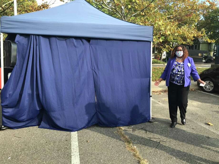 New Haven Assistant Superintendent Keisha Redd-Hannans emerges from a tent in the parking lot of King/Robinson school after receiving a nasal swab test for COVID-19 on Oct. 22, 2020. Photo: Brian Zahn/Hearst Connecticut Media