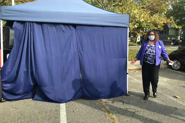 New Haven Assistant Superintendent Keisha Redd-Hannans emerges from a tent in the parking lot of King/Robinson school after receiving a nasal swab test for COVID-19 on Oct. 22, 2020.