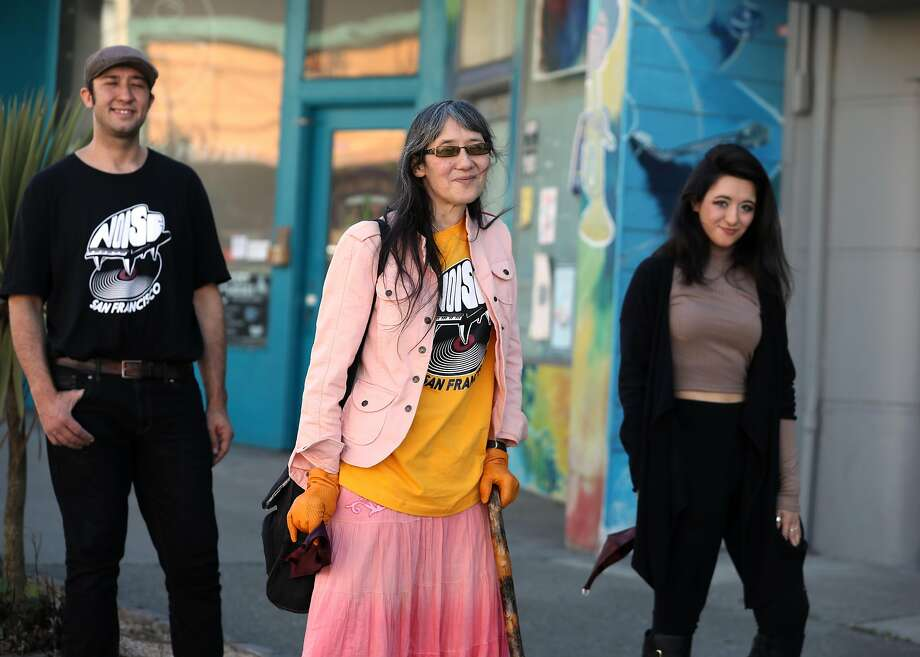 Chief clerk Sara Johnson (front) greets her neighbors flanked by her son and noted saxophonist Daniel Brown (left) and daughter Sara Brown (right) next to Noise, their record store and performing venue in the Outer Richmond seen on Thursday, Oct. 15, 2020, in San Francisco, Calif. Photo: Liz Hafalia / The Chronicle