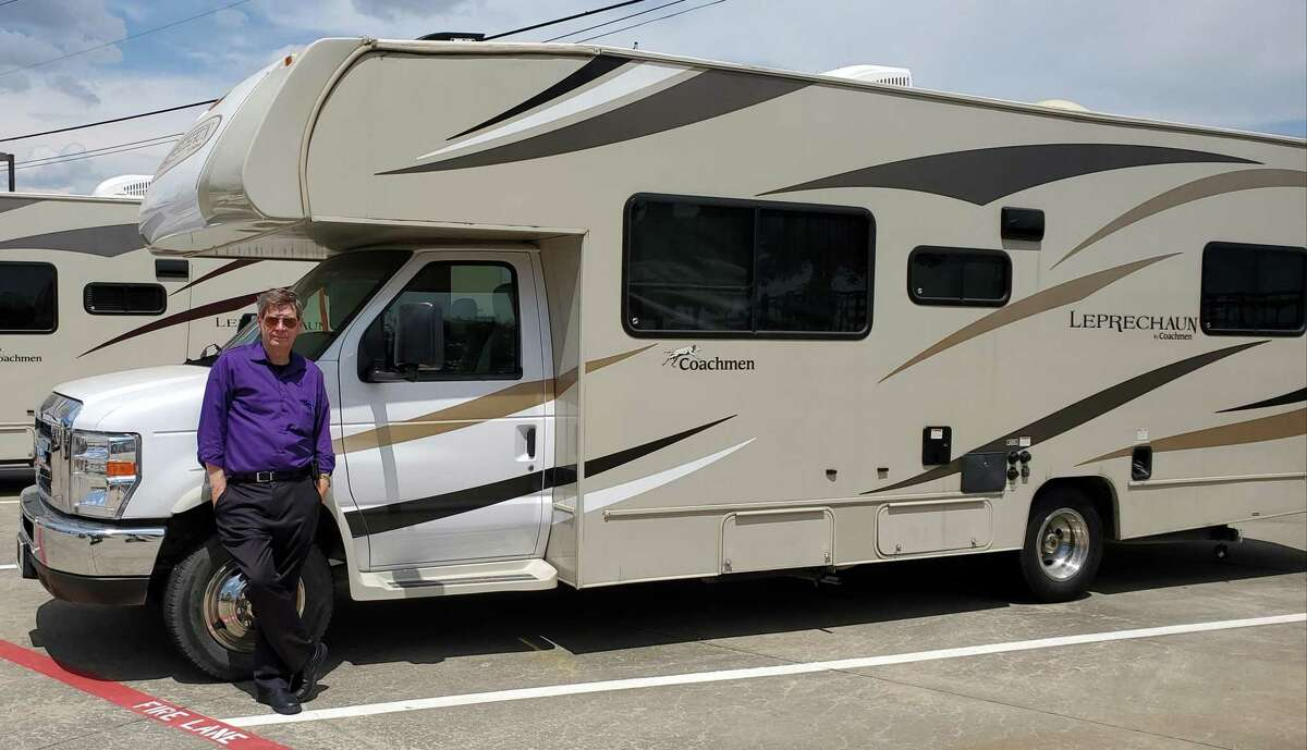 Michael Fjetland with his RV: He and his girlfriend will spend this Thanksgiving on the road.
