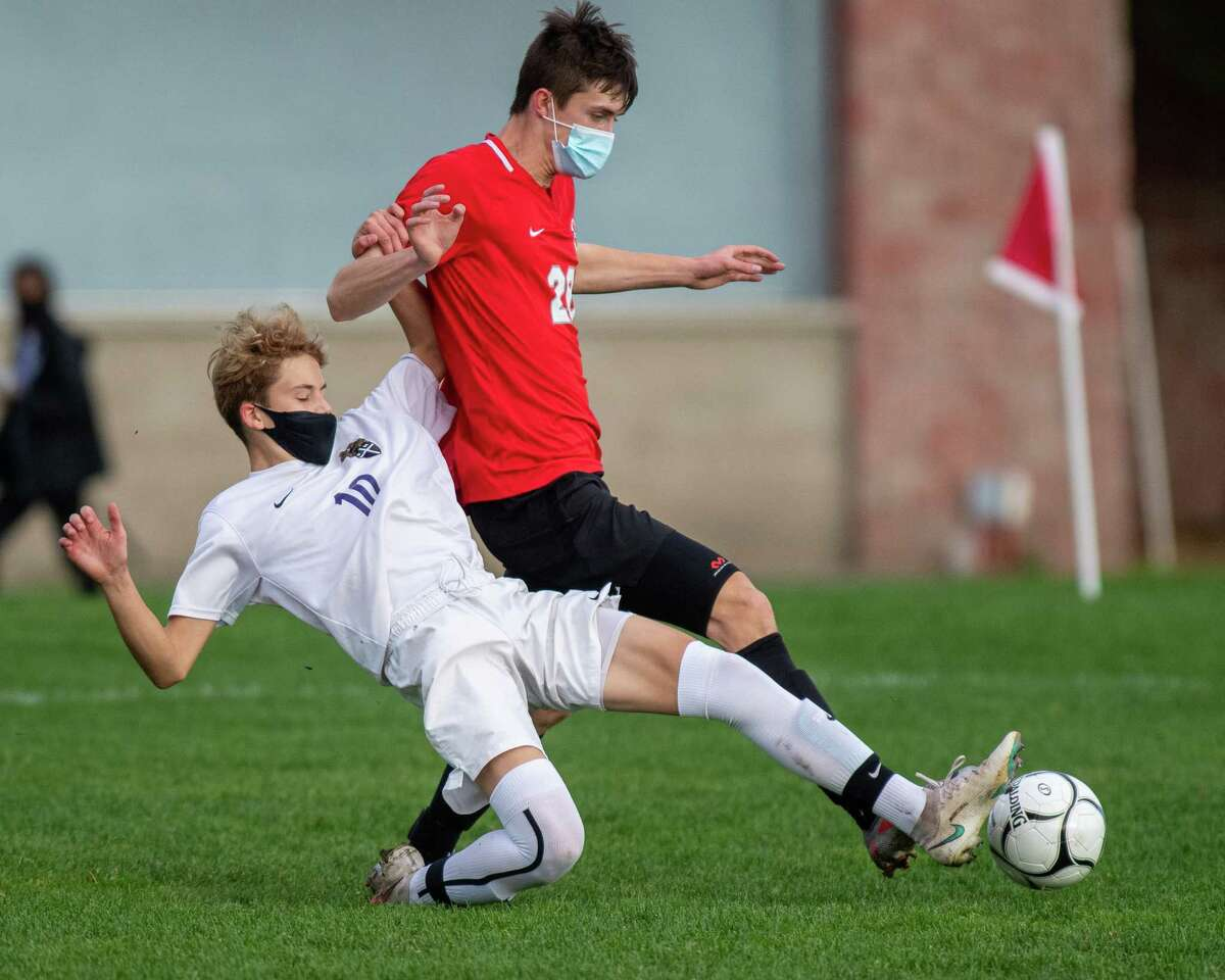 CBA junior Paul Abbatiello (white) and Niskayuna senior Toby Goldner (red) battle for the ball during a Suburban Council matchup at Niskayuna High School in Niskayuna, NY, on Thursday, Oct. 22, 2020 (Jim Franco/special to the Times Union.)