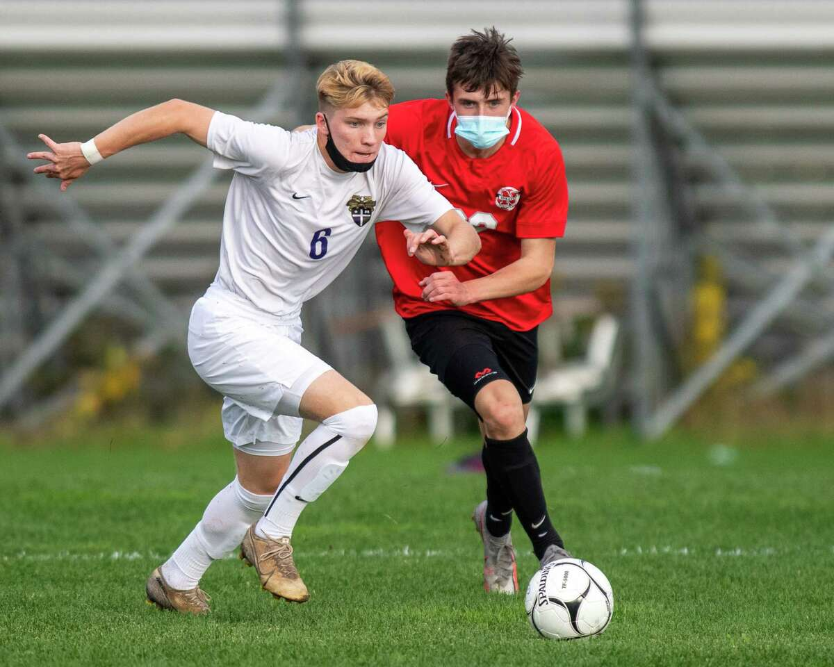 CBA senior Dolin Connor (white) and Niskayuna senior Toby Goldner (red) battle for the ball during a Suburban Council matchup at Niskayuna High School in Niskayuna, NY, on Thursday, Oct. 22, 2020 (Jim Franco/special to the Times Union.)