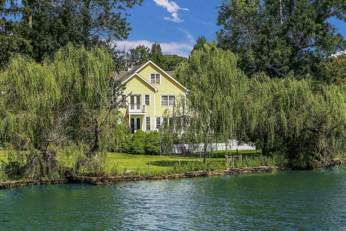 This home on the banks of Tide Mill Pond in Southport offers spectacular views and 200 feet of direct water-frontage.