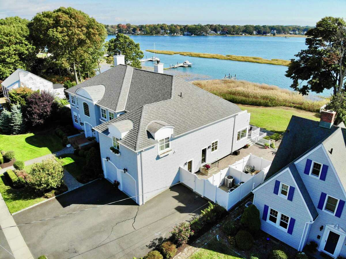 This 16-room Stratford residence, located directly on the Housatonic River, has its own dock and heated in-ground saltwater pool.