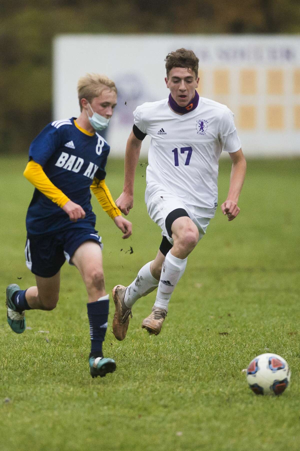 Calvary Baptist's Toby Stauffer chases down the ball during a district final game against Bad Axe Thursday, Oct. 22, 2020 at Calvary Baptist Academy. (Katy Kildee/kkildee@mdn.net)
