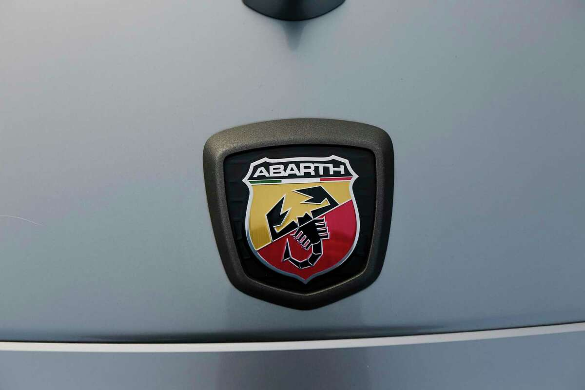 The emblem on a 2017 Fiat Abarth 124 vehicle as car owners gather for a car meet in a parking lot along Northwest Freeway Saturday, Oct. 10, 2020, in Houston.