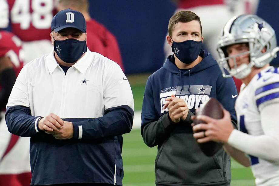 Dallas Cowboys head coach Mike McCarthy, left, and offensive coordinator coach Kellen Moore watch quarterback Andy Dalton warm up before an NFL football game against the Arizona Cardinals at AT&T Stadium on Monday, Oct. 19, 2020, in Arlington, Texas. (Smiley N. Pool/The Dallas Morning News/TNS) Photo: Smiley N. Pool, MBR / TNS / Dallas Morning News