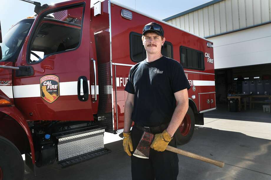 First-year Cal Fire firefighter Anders Carlson stands by his bus at the fire station on Tuesday, Oct. 20, 2020, in Winters, Calif. Photo: Liz Hafalia / The Chronicle