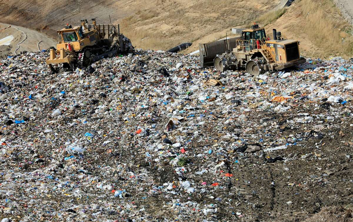 Trash compactors work at Potrero Hills Landfill in Solano County in 2009. A U.S. appeals court ruled Thursday that the Trump administration was authorized to change legal deadlines and delay Obama-era rules intended to limit emissions of methane and other pollutants from the nation's landfills.