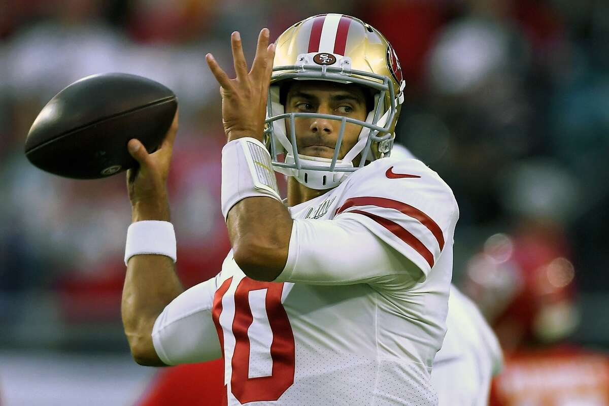 San Francisco 49ers' quarterback Jimmy Garoppolo warms up before the NFL Super Bowl 54 football game against the Kansas City Chiefs Sunday, Feb. 2, 2020, in Miami Gardens, Fla. Three years after being traded away by the Patriots, Garoppolo returns to New England as San Francisco's starting quarterback having led the 49ers to the Super Bowl last season.(AP Photo/Mark J. Terrill, File)
