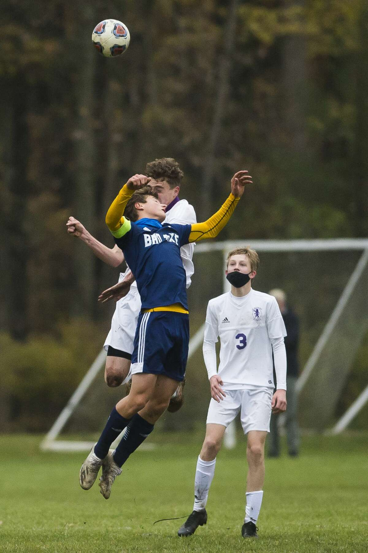 Bad Axe's Nick Errer and Calvary Baptist's Toby Stauffer jump up for a header during their district final Thursday, Oct. 22, 2020 at Calvary Baptist Academy. The Bad Axe boys soccer team captured its third straight district championship on Thursday after defeating host Midland Calvary Baptist, 4-1.