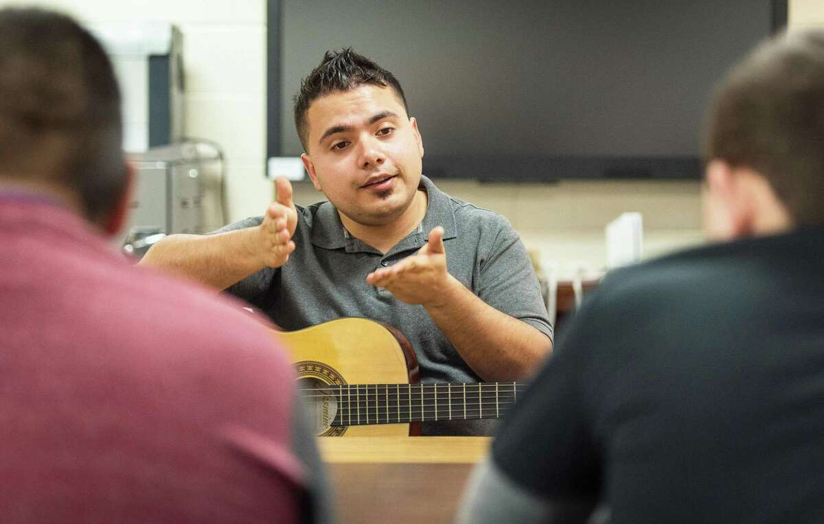 Music therapist Omar Reyna from the Harris County Department of Education uses his guitar and music to work with students needing assistance. Cypress Fairbanks ISD has one of the largest contingents of music therapists in a school district.